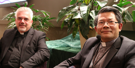 Fr Fabio Baggio (left) and Bishop Vincent Long at the colloquium in Brisbane last night (The Catholic Leader/Mark Bowling)
