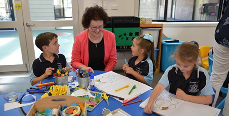 Jacinta Collins with students from St Joseph's Primary Gladstone earlier this year (NCEC)