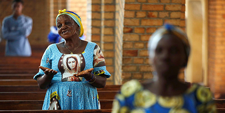 Women pray during a Mass at the cathedral in Kinshasa, Congo in 2018. Catholics make up nearly half of Congo's 80 million people (CNS/Baz Ratner, Reuters)