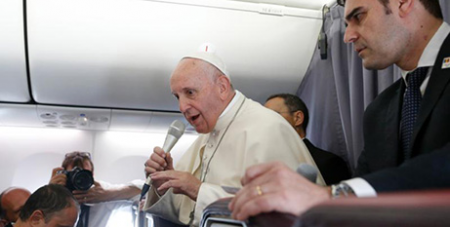 Pope Francis speaks to journalists on the papal flight to Mozambique (CNS/Paul Haring)