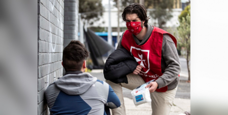 An Order of Malta volunteer distributes a care pack as part of its Coats for the Homeless program (Facebook/Order of Malta Australia)
