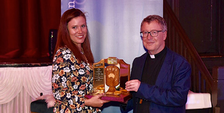 The Good Oil's Nichol Plumb accepts the Bishop Kennedy Award from Bathurst Bishop Michael McKenna (ACPA/Neil Helmore)
