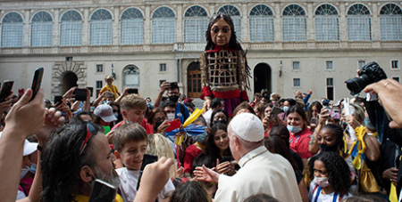 Pope Francis greets Little Amal and activists raising awareness about the plight of unaccompanied refugee minors at the Vatican on Friday (CNS photo/Vatican Media)