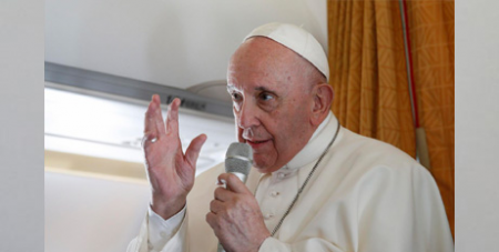 Pope Francis answers questions from journalists aboard his flight from Slovakia to Rome yesterday (CNS/Paul Haring)