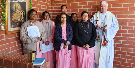 (From left) Sisters Jacqueline, Leonie, Nancy, Elizabeth, Delma and Sheela with Bishop Greg O'Kelly SJ at the new convent house (The Southern Cross)