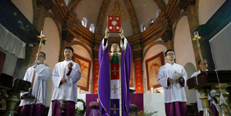 A priest celebrates Mass in Beijing in December 2016 (CNS/How Hwee Young, EPA)