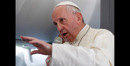 Pope Francis answers questions on the papal plane yesterday (CNS/Paul Haring)