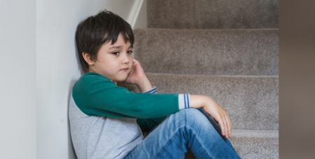 A sore tummy in the morning before school can be a sign of anxiety in children (Bigstock)