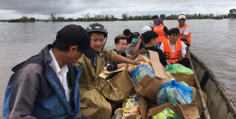 Fr Peter Phuc SJ (left) and friends with aid for flood victims in central Vietnam (Jesuit Mission)