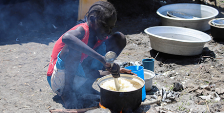 Preparing a meal outside a makeshift shelter in Gumuruk, South Sudan, earlier his month (CNS/Samir Bol, Reuters)