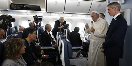 Pope Francis addresses reporters aboard the papal plane yesterday (CNS/Paul Haring)