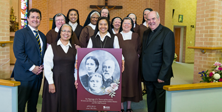 Damien MacRae (left) and Fr Brian Lucas (right) with Carmelite Sisters at Varroville last week (Catholic Mission/Simone Medri)