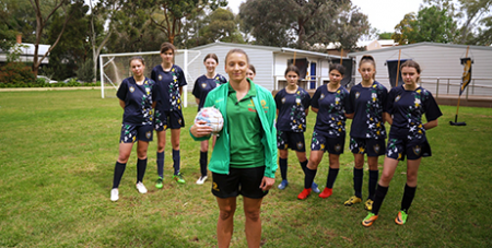 Socktober ambassador and Adelaide United soccer player Sarah Willacy with students from Mary Mackillop College in Adelaide (Catholic Mission)
