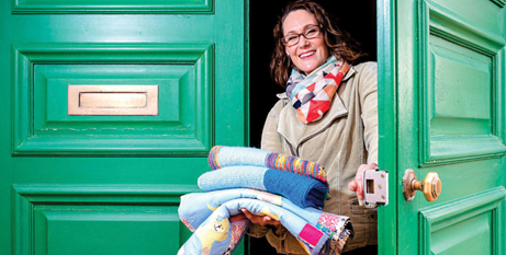 Birthline director Sally Alford with donated handmade blankets. (Nat Rogers/The Southern Cross)