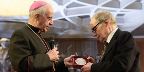Cardinal Gianfranco Ravasi presents Ennio Morricone with the Pope Francis Medal in 2019 (Vatican Media)