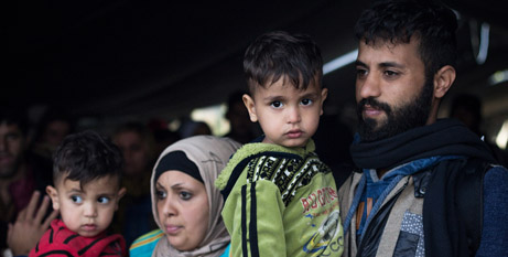 A refugee family waits for resettlement in Berkasovo, Serbia (Bigstock)